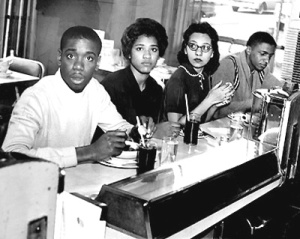 60civilrights14...Negro students, Matthew Walker, left, Peggy Alexander, Diane Nash and Stanley Hemphill, eat lunch at the previously segregated counter of the Post House Restaurant in the Greyhound bus terminal. This marked the first time since the start of the sit-in that Negroes have been served at previously all-white counters in Nashville. Staff photo by Gerald Holly (The Tennessean) 5/16/1960